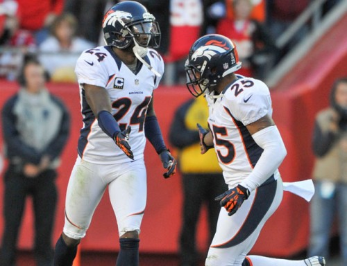 Champ Bailey e Chirs Harris no jogo contra o Texans.